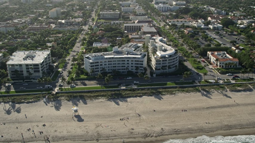 5K stock footage aerial video of condominium complexes by the beach, Palm Beach, Florida Aerial Stock Footage | AX0032_079