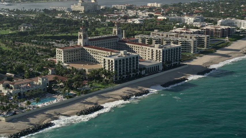 5K stock footage aerial video of approaching The Breakers Palm Beach hotel in Palm Beach, Florida Aerial Stock Footage | AX0032_080