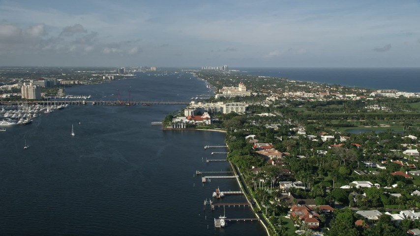 5K stock footage aerial video of Flagler Memorial Bridge, Henry Morrison Flagler Museum, Palm Beach, Florida Aerial Stock Footage | AX0032_100