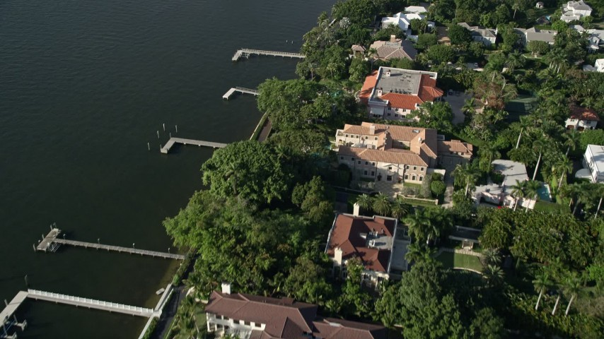 5K stock footage aerial video of mansions, Intracoastal Waterway, Henry Morrison Flagler Museum, Palm Beach, Florida Aerial Stock Footage | AX0032_101