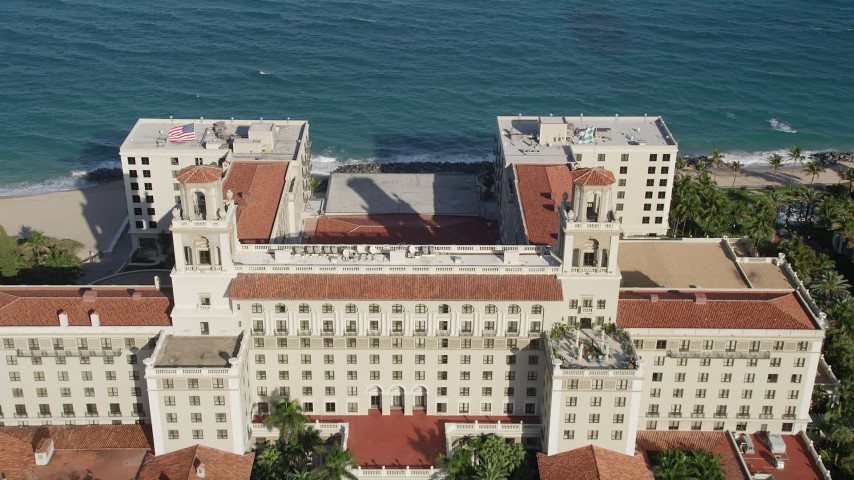 5K stock footage aerial video of The Breakers Palm Beach, tilt down on Atlantic Ocean, Palm Beach, Florida Aerial Stock Footage | AX0032_103