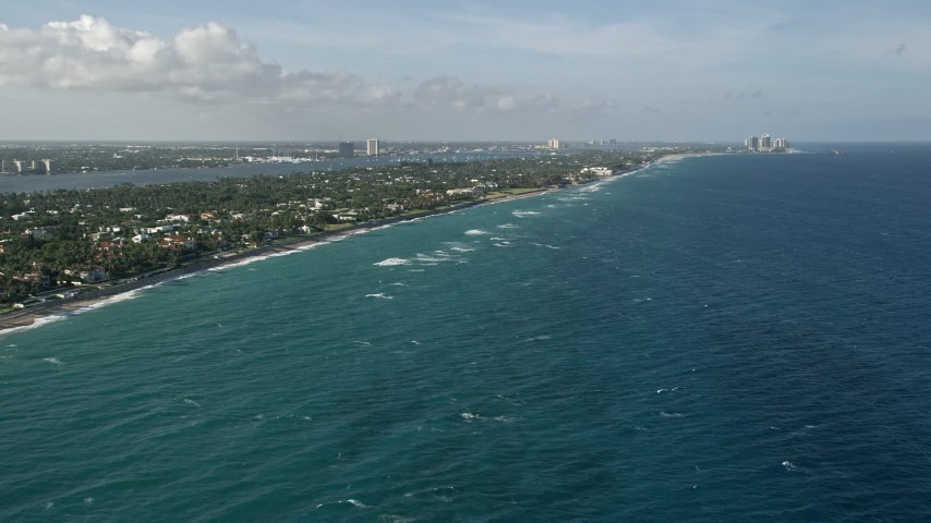 5K stock footage aerial video of flying by the coast, Palm Beach, Florida Aerial Stock Footage | AX0032_104