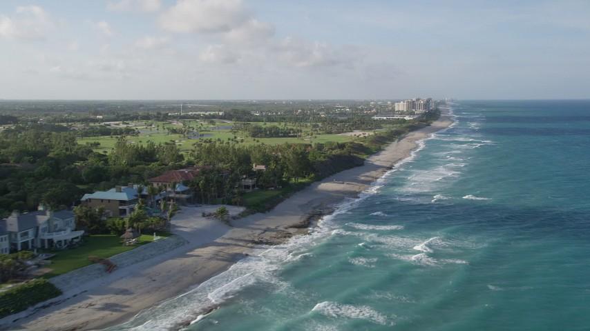 5K stock footage aerial video of flying along the coast near Juno Beach, Seminole Golf Club, Juno Beach, Florida Aerial Stock Footage AX0032_126   Axiom Images