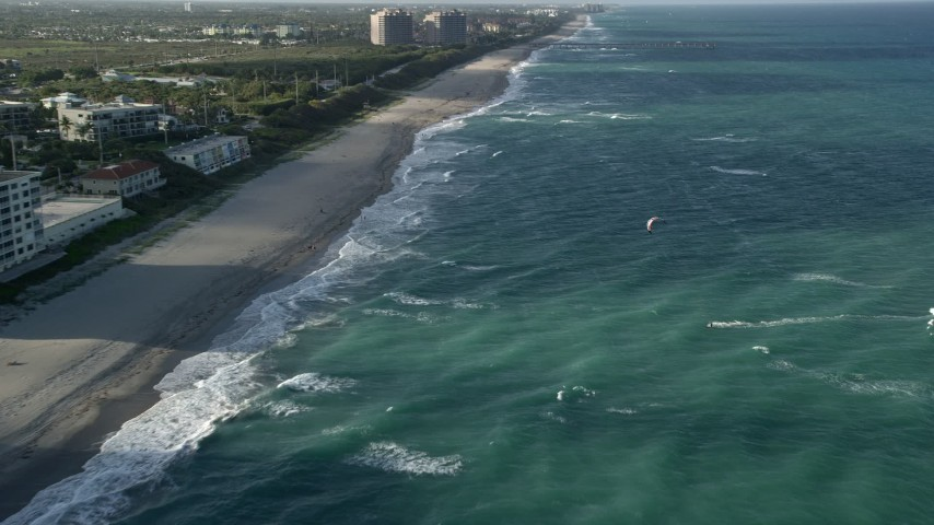 5K stock footage aerial video of flying by the beach, approaching kite surfer, Juno Beach, Florida Aerial Stock Footage | AX0032_130