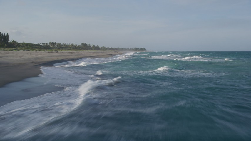 5K aerial video of flying low over waves, veer right over the Atlantic, Hobe Sound, Florida Aerial Stock Footage AX0032_150
