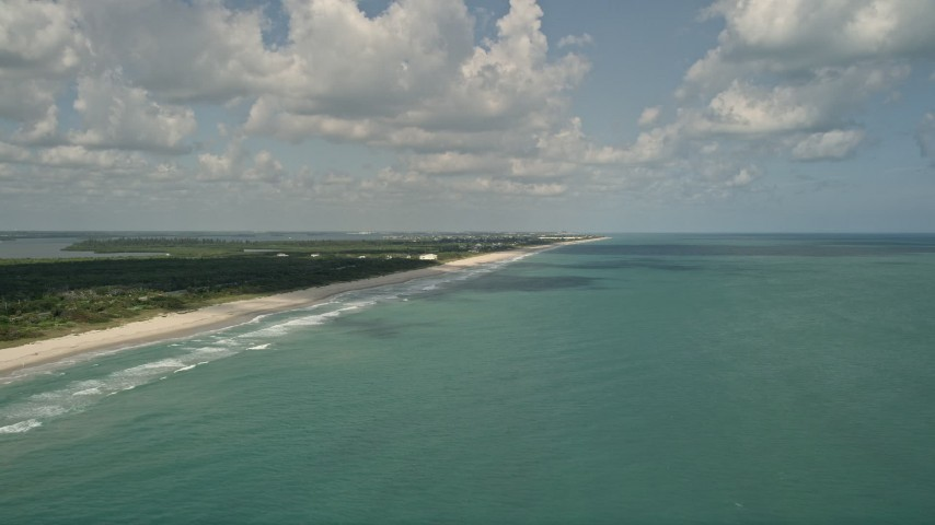 5K stock footage aerial video of approaching coastal beach and blue waters, Vero Beach, Florida Aerial Stock Footage   AX0033_050