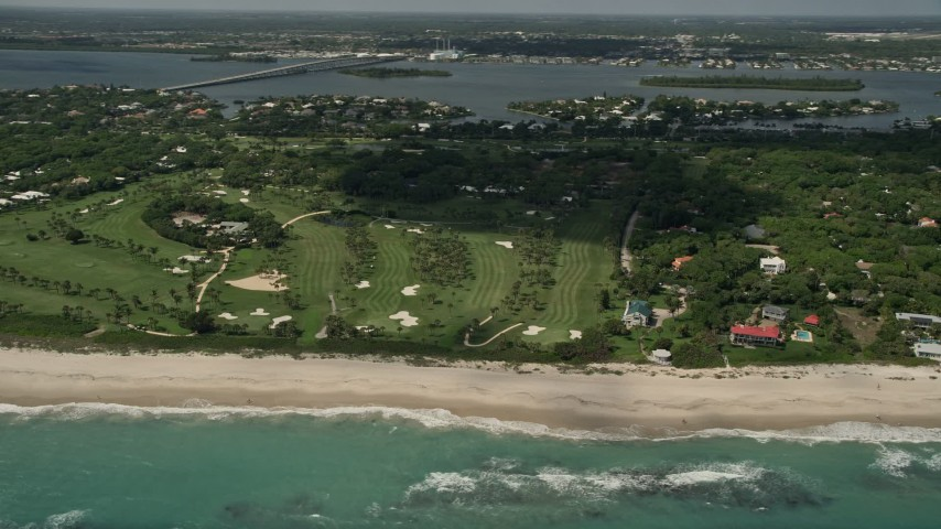 5K stock footage aerial video of flying away from a beachside golf course, Vero Beach, Florida Aerial Stock Footage | AX0033_061