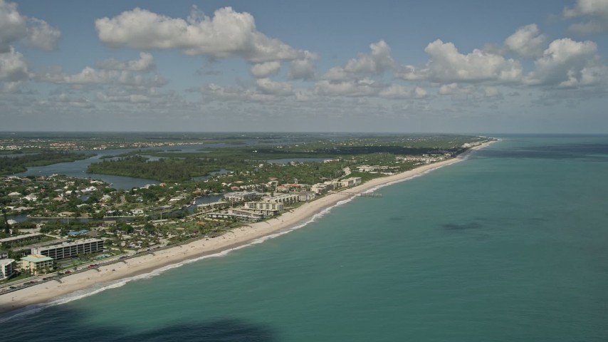 5K stock footage aerial video of flying by the beach and a coastal community, Vero Beach, Florida Aerial Stock Footage   AX0033_062