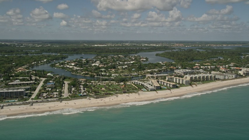 5K stock footage aerial video fly by beachside condominiums, Vero Beach, Florida Aerial Stock Footage | AX0033_063