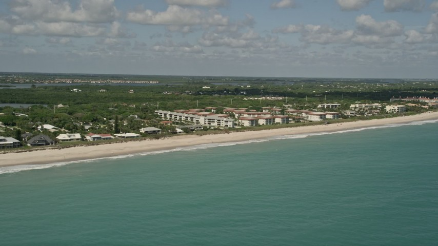 5K stock footage aerial video of flying by a beach side condominium complex, Vero Beach, Florida Aerial Stock Footage | AX0033_064