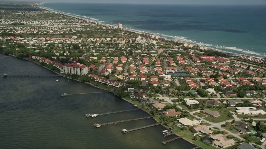 5K stock footage aerial video of approaching a residential neighborhood on the river banks, Melbourne Beach, Florida Aerial Stock Footage | AX0033_069