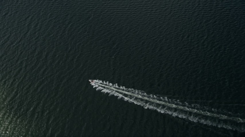 5K stock footage aerial video of tracking a speedboat in the river, Melbourne Beach, Florida Aerial Stock Footage | AX0033_073