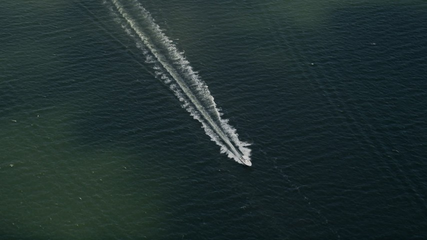 5K stock footage aerial video of fishing boat approaching, Melbourne Beach, Florida Aerial Stock Footage | AX0033_074