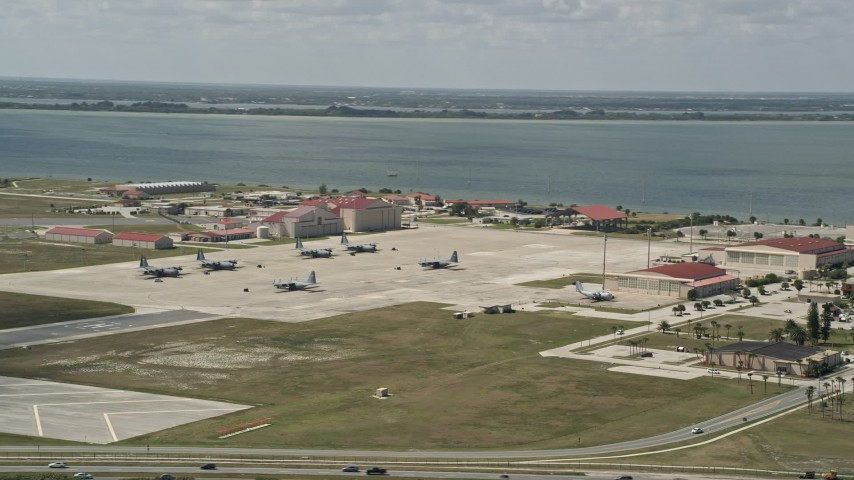 5K stock footage aerial video of parked turboprop military planes, Patrick Air Force Base, Florida Aerial Stock Footage | AX0034_005