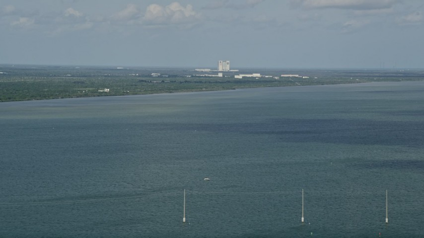 5K stock footage aerial video of Cape Canaveral seen from across Banana River, Florida Aerial Stock Footage | AX0034_022