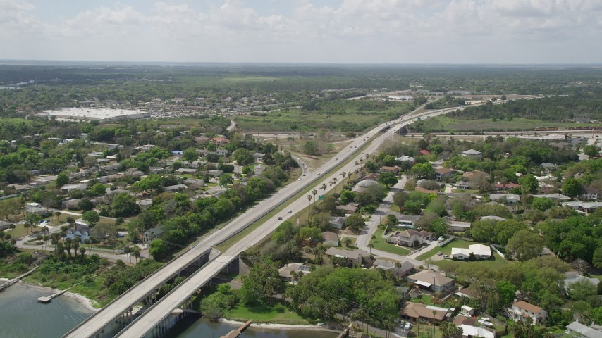 5K stock footage aerial video of approaching an expressway through a residential neighborhood, Cocoa, Florida Aerial Stock Footage | AX0034_027