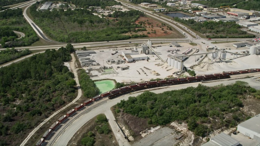 5K aerial stock footage video of approaching a quarry, Cocoa, Florida Aerial Stock Footage | AX0034_029