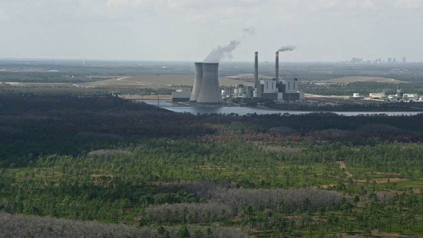 5K stock footage aerial video of approaching a coal fired power generation facility, Orlando, Florida Aerial Stock Footage | AX0034_074