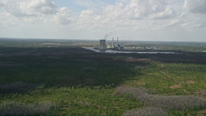 5K stock footage aerial video of approaching a coal fired power generation facility, Orlando, Florida Aerial Stock Footage | AX0034_075