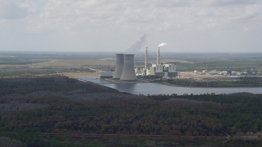 5K stock footage aerial video approach to a a coal fired power generation facility, Orlando, Florida Aerial Stock Footage | AX0034_076