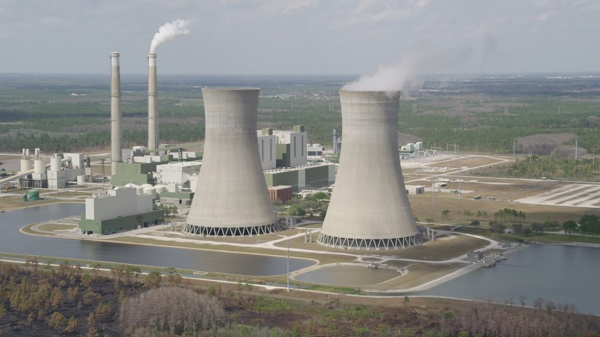 5K stock footage aerial video of passing by a coal fired power generation facility, Orlando, Florida Aerial Stock Footage | AX0034_079