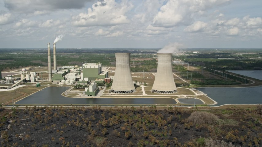 5K stock footage aerial video of flying by a coal fired power generation facility, Orlando, Florida Aerial Stock Footage | AX0034_080