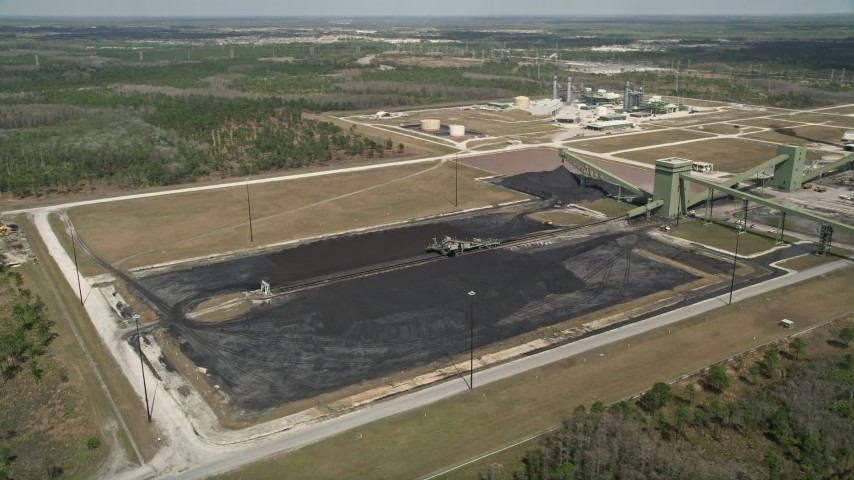 5K stock footage aerial video of approaching part of a coal fired power generation facility, Orlando, Florida Aerial Stock Footage | AX0034_081