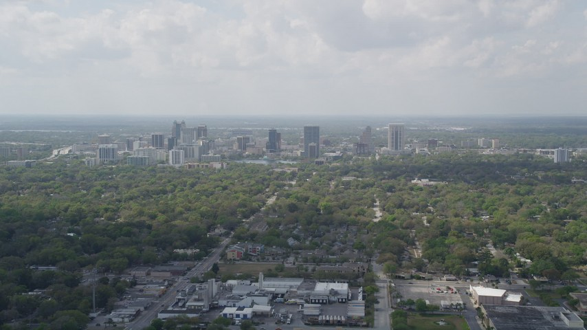 5K stock footage aerial video fly over trees toward Downtown Orlando, Florida Aerial Stock Footage | AX0034_083