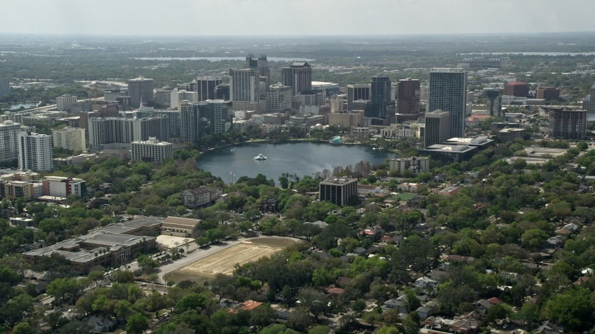 5K stock footage aerial video of Lake Eola and Downtown Orlando, Florida Aerial Stock Footage | AX0034_085