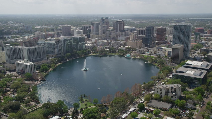 5K stock footage aerial video of flying over Lake Eola toward Downtown Orlando, Florida Aerial Stock Footage | AX0034_087
