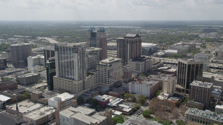 5K stock footage aerial video of flying over Downtown and approaching SunTrust Center, Downtown Orlando, Florida Aerial Stock Footage | AX0034_088