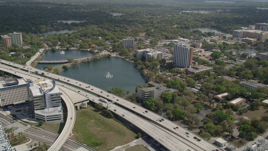 5K stock footage aerial video of Lake Lucerne next to the Expressway, Downtown Orlando. Florida Aerial Stock Footage | AX0034_090