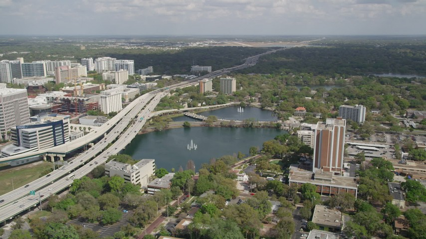 5K stock footage aerial video of orbiting Lake Lucerne near the Expressway, Downtown Orlando, Florida Aerial Stock Footage | AX0034_091