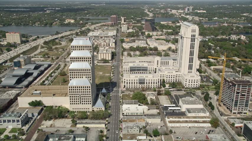 5K stock footage aerial video of following Orange Avenue through Downtown Orlando, Florida Aerial Stock Footage | AX0034_094E