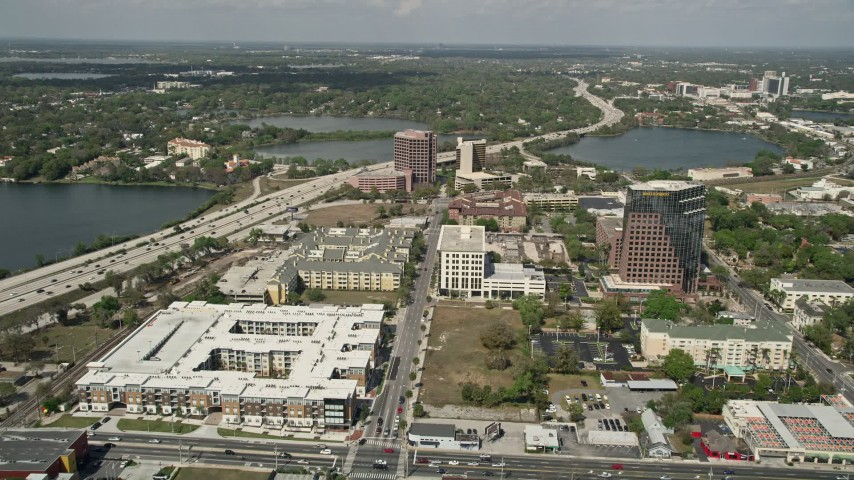 5K stock footage aerial video of apartment and office buildings along North Orange Avenue, Downtown Orlando, Florida Aerial Stock Footage | AX0034_096
