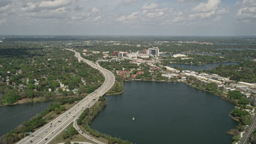 5K stock footage aerial video of approaching interstate beside a lake, Orlando, Florida Aerial Stock Footage | AX0034_097