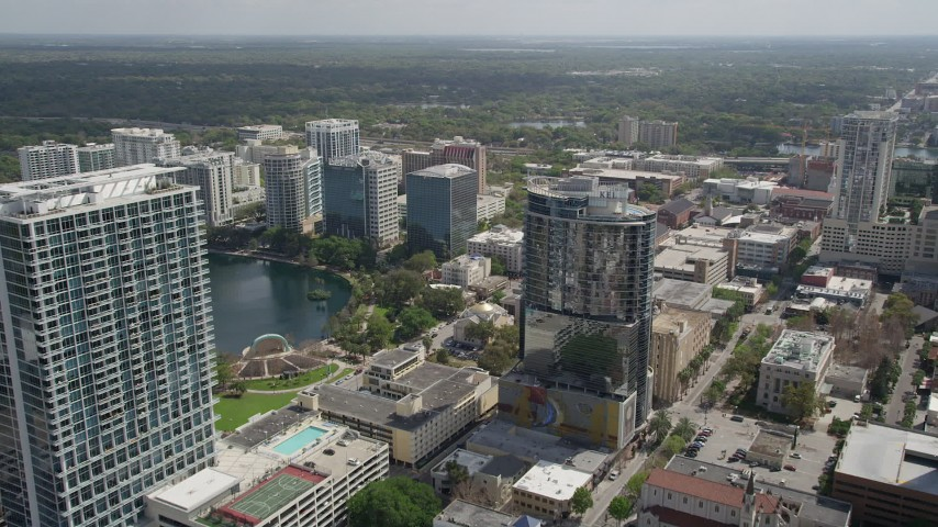 5K stock footage aerial video of approaching condominium complex and office buildings, Downtown Orlando, Florida Aerial Stock Footage   AX0034_101