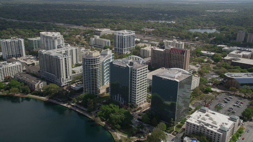 5K stock footage aerial video of flying over condominium complexes and office buildings, Downtown Orlando, Florida Aerial Stock Footage | AX0034_102
