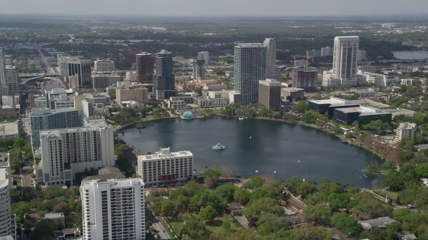 5K stock footage aerial video of passing by Lake Eola and Downtown Orlando, Florida Aerial Stock Footage | AX0034_103