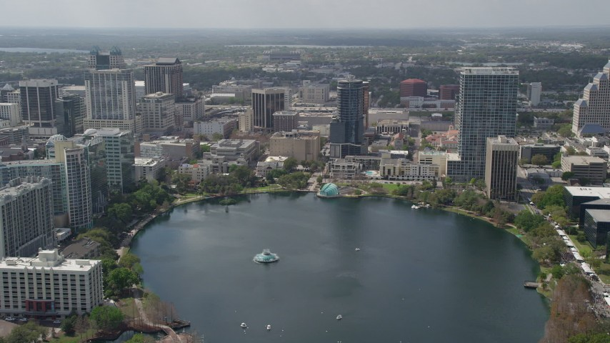 5K stock footage aerial video of a view across Lake Eola and Downtown Orlando, Florida Aerial Stock Footage | AX0034_104