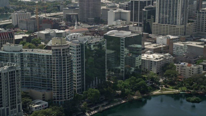 5K stock footage aerial video of condominium complex and office buildings, Downtown Orlando, Florida Aerial Stock Footage | AX0034_105