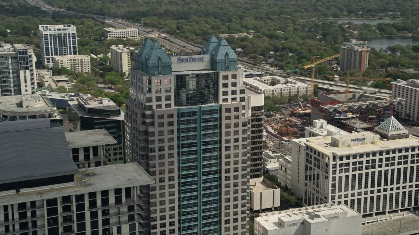 5K stock footage aerial video of orbiting the SunTrust Center, Downtown Orlando, Florida Aerial Stock Footage | AX0034_109