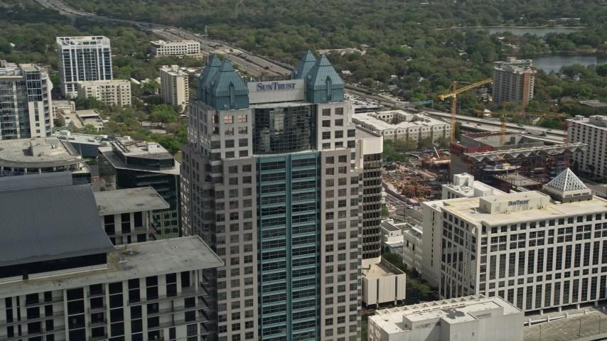 5K stock footage aerial video of orbiting the SunTrust Center, Downtown Orlando, Florida Aerial Stock Footage | AX0034_109