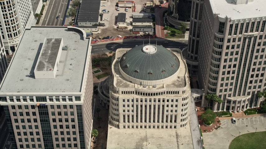 5K stock footage aerial video approach and tilt to a bird's eye of Orlando City Hall, Downtown Orlando, Florida Aerial Stock Footage | AX0034_110