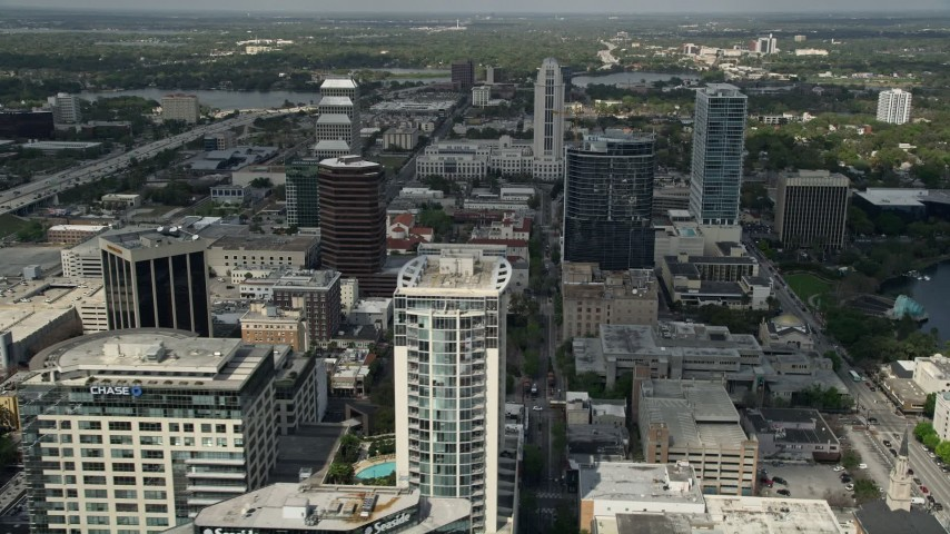 5K stock footage aerial video flyby skyscrapers and high-rise office buildings, Downtown Orlando, Florida Aerial Stock Footage | AX0034_111
