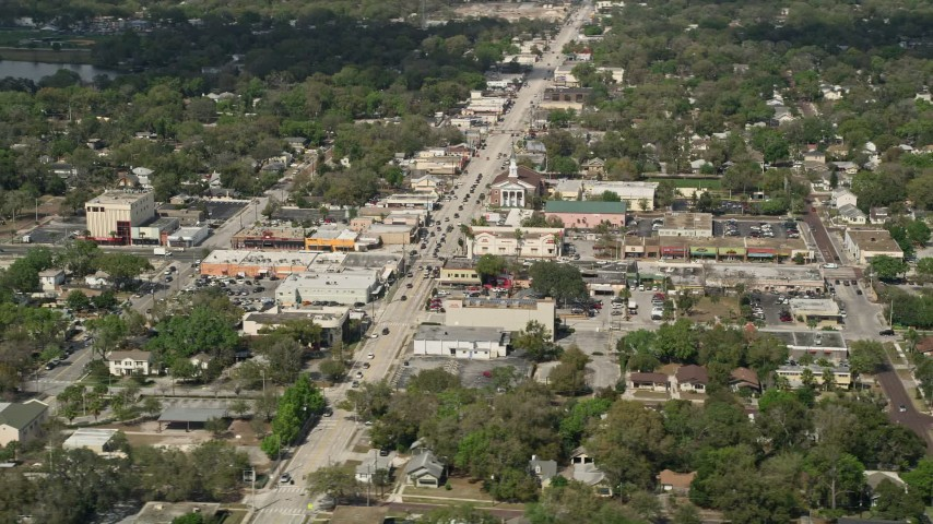 5K stock footage aerial video of a small church and shops beside a busy street, Orlando, Florida Aerial Stock Footage | AX0034_113