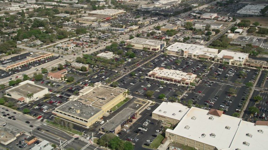 5K stock footage aerial video of approaching a shopping mall and parking lot, Orlando, Florida Aerial Stock Footage | AX0034_114