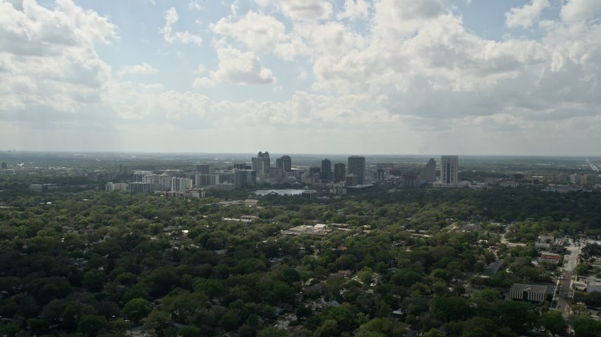 5K stock footage aerial video of Downtown Orlando skyline seen from a distance, Florida Aerial Stock Footage   AX0035_001