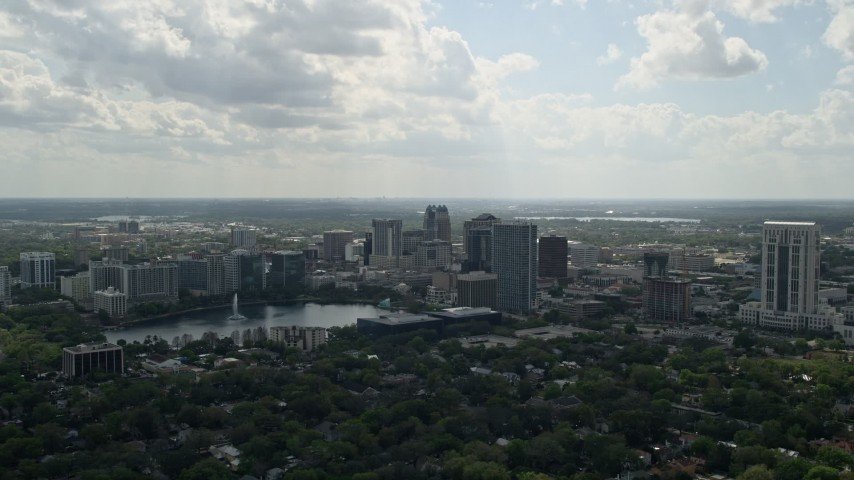 5K stock footage aerial video of Downtown Orlando buildings along Lake Eola, Florida Aerial Stock Footage | AX0035_003