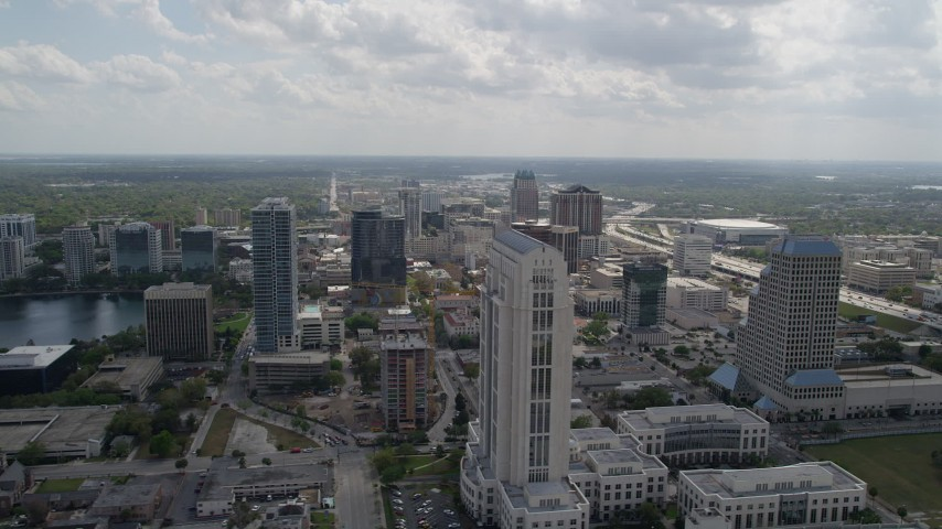 5K stock footage aerial video flyby courthouse and skyscraper in Downtown Orlando, Florida Aerial Stock Footage | AX0035_004